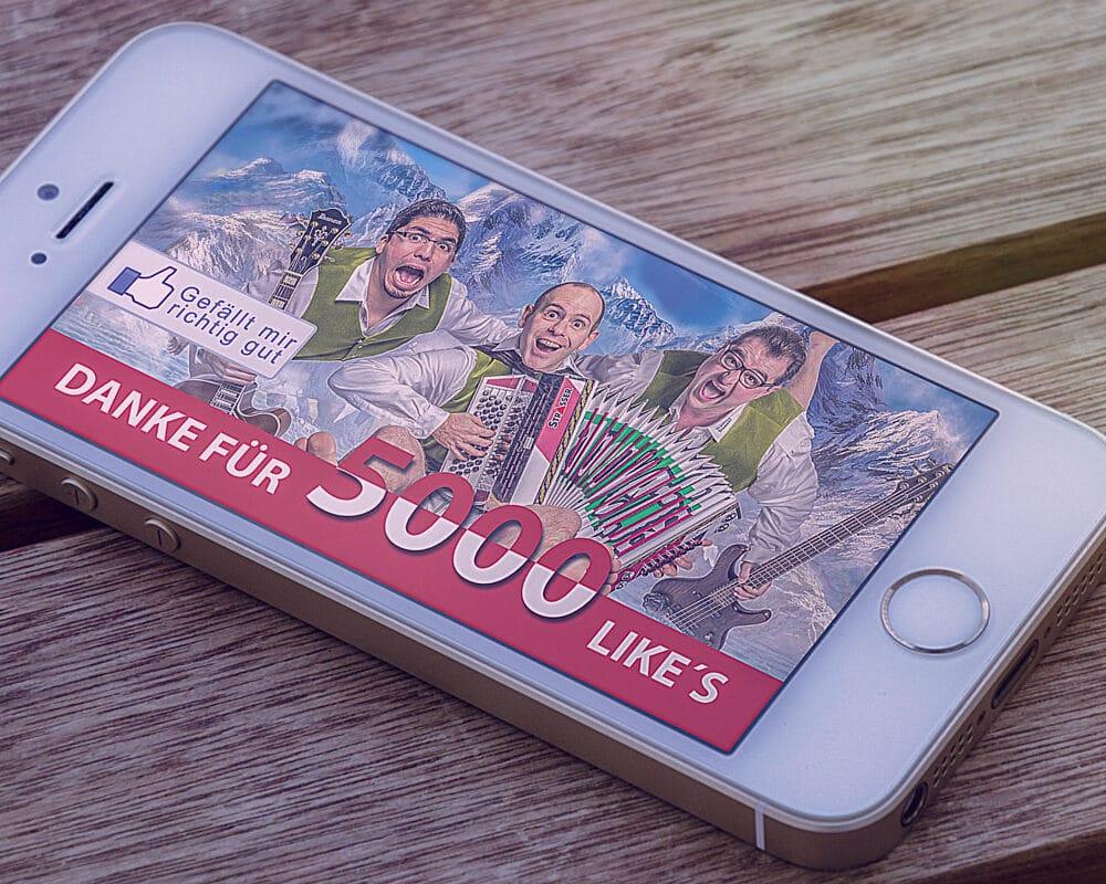 Smartphone mit Webgrafik der Alpenyetis