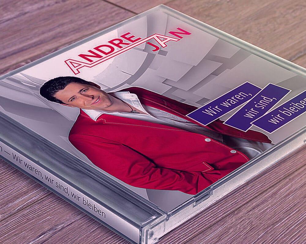 CD-Hülle von Andre Jan auf einem Holztisch