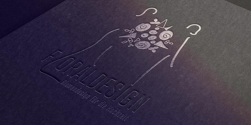 Buchumschlag dunkel mit dem Floraldesign Logo