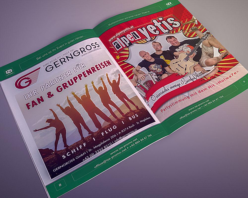 IZE-Promo Katalog aufgeschlagen, Gerngroßreisen und Alpenyetis, auf grauem Hintergrund
