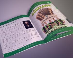 IZE-Promo Katalog aufgeschlagen 1. Seite, auf grauem Hintergrund